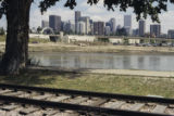 Denver skyline, South Platte River, and trolley tracks from near Gates-Crescent Park