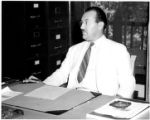 Professor Arthur L. Campa at desk
