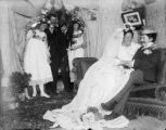 Bride and groom on couch holding each other