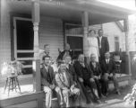 Group of adults seated on a porch