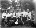 Group posed for a photograph in a park