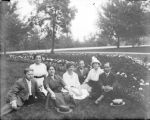 Small group seated in a park