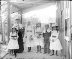 "Woman and five children on porch a ""dress-up"" occasion"