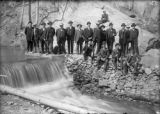 Men near an irrigation ditch
