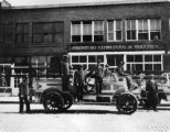 Fire fighters in front of print shop