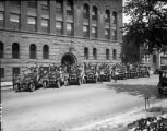 An excursion of eight White tourist cars assembled in front of the old Denver Athletic Club...