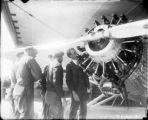 Charles A. Lindbergh inspecting an early airplane