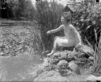 Lady in lily pond