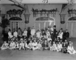 Mrs. Hazel (Rhoads) Gates with Gates' employees' children