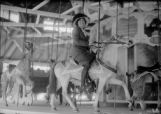 Harry's first wife, Julia Knapp, on merry-go-round at Manhattan Beach