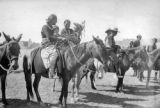 Pueblo Indians on horseback.