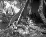 Utes, showing interior of tepee Dick Charlie and family