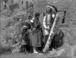San Juan Indians at cliff dwellings at Manitou, Colo. Chief Juan Cruz, baby Julianita, woman...