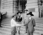 Gov. Morely (?) in cowboy hat and other westerners