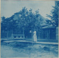 Unidentified woman and building