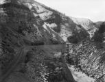 Eagle River Canyon outfit (work) cars and steam shovel on line east of river - eastbound line on...
