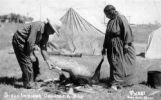 Sioux Indians cooking a dog