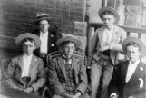 Group of young men - in suits and straw hats