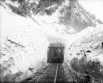 D&RG narrow gauge caboose 0548 at the Snowslide Tunnel, MP 492 1/2, above Elk park, Colorado,...