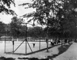 At one end of Rocky Mountain Lake Park [i.e. City Park] is a battery of four tennis courts