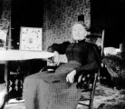 Mrs. J. M. Chesnut in her living room, Crested Butte, Colo.