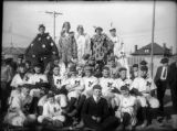 Manual High. Teachers' baseball team and boys in costume