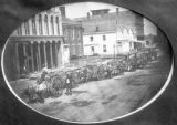 A line of carts and mules on the street of town