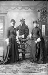 Lt. Charles C. DeRudio, standing between two daughters