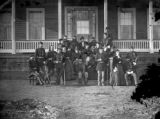 General Custer, officers and ladies at Fort Lincoln, house in background