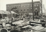 Debris at 2nd and Grand Ave., showing high water line