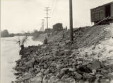 Repairing levee near Fourth Street