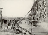D. & R.G. pile driver, driving temporary bridge across river, A.T. & S.F. bridge on right,...
