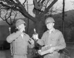 Two soldiers with liquor and cigars