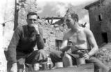 Lt. Wilbur Sheets and Captain Harold Osborne at lunch in Pietra Colora, Italy