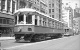 T.E. car 328 followed by 660 Birney Dallas Ry. & Terminal car