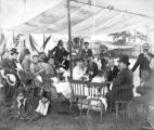 William F. Cody and group eating lunch under tent