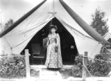 Annie Oakley in front of tent