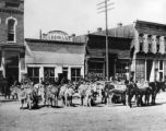 A burro pack train in Gunnison Main Street looking slightly to southwest, from near corner of...