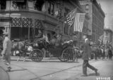 Former President Theodore Roosevelt in carriage waves greetings to Denver spectators ... as his...