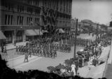 Troops parading in front of Brown Palace