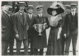 Mrs Brown presents cup to Captain Rostard [i.e. Rostron] of Cunard Line commemorating rescue from...