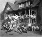 Workmen who built home sitting on porch