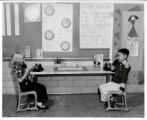 Greenlee School students on telephones