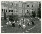 Skinner Junior High School weeding lawn