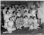 Kismet Club members.  Group photo of members with lollipops and dolls.