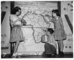 Asbury Elementary School students with map of Africa