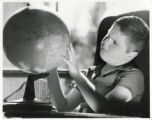 Charles Boettcher School student with globe