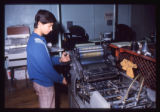 West High School student with printing press