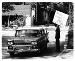 Protest, Mountain Bell vs. CHUN, man with a sign and car