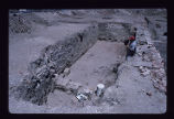 Tremont House, unidentified individual standing in open trench
